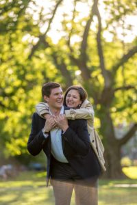 hugging engagement photos in boston commons