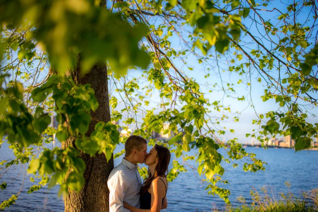 engagement photo kissing by the charles river