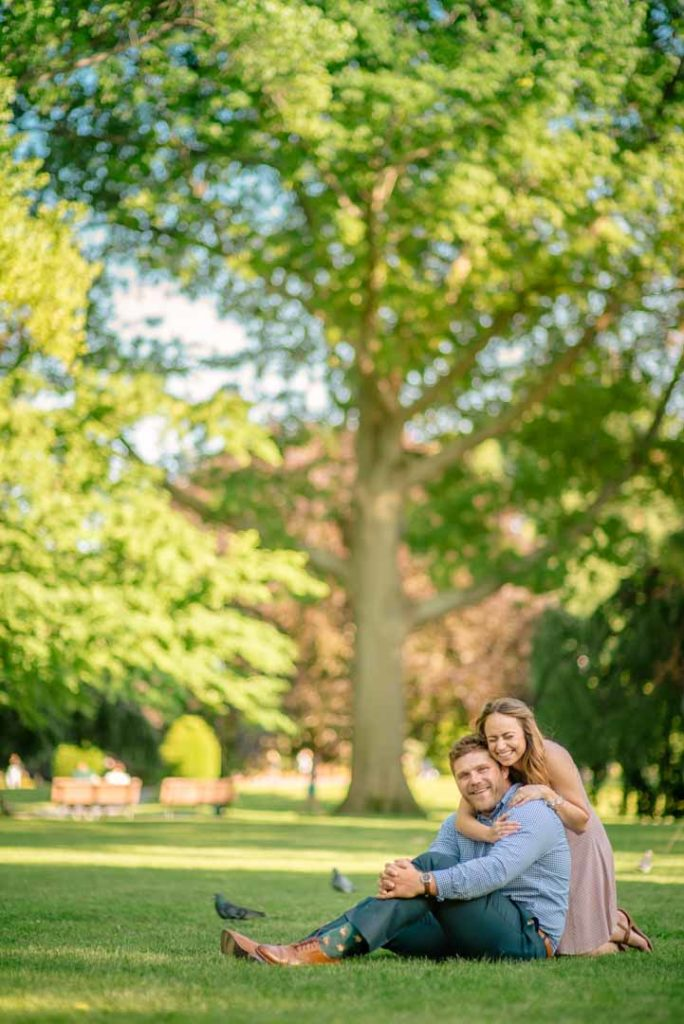 engagement photo sitting on grass