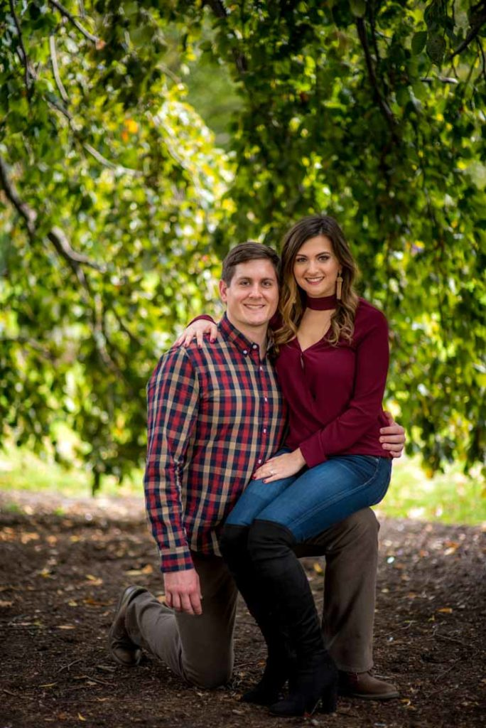 engagement photo in boston commons in front of the tree