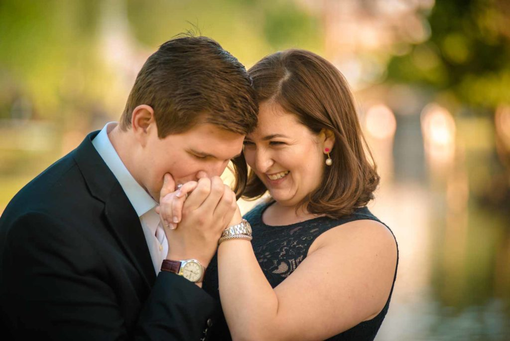 engagement photography. kissing the hand. Showing affection