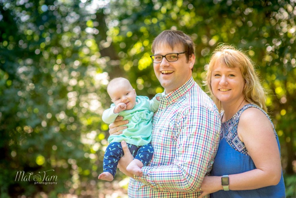 4 month old girl photos session at shannon beach in Winchester, MA with parents. Family photo