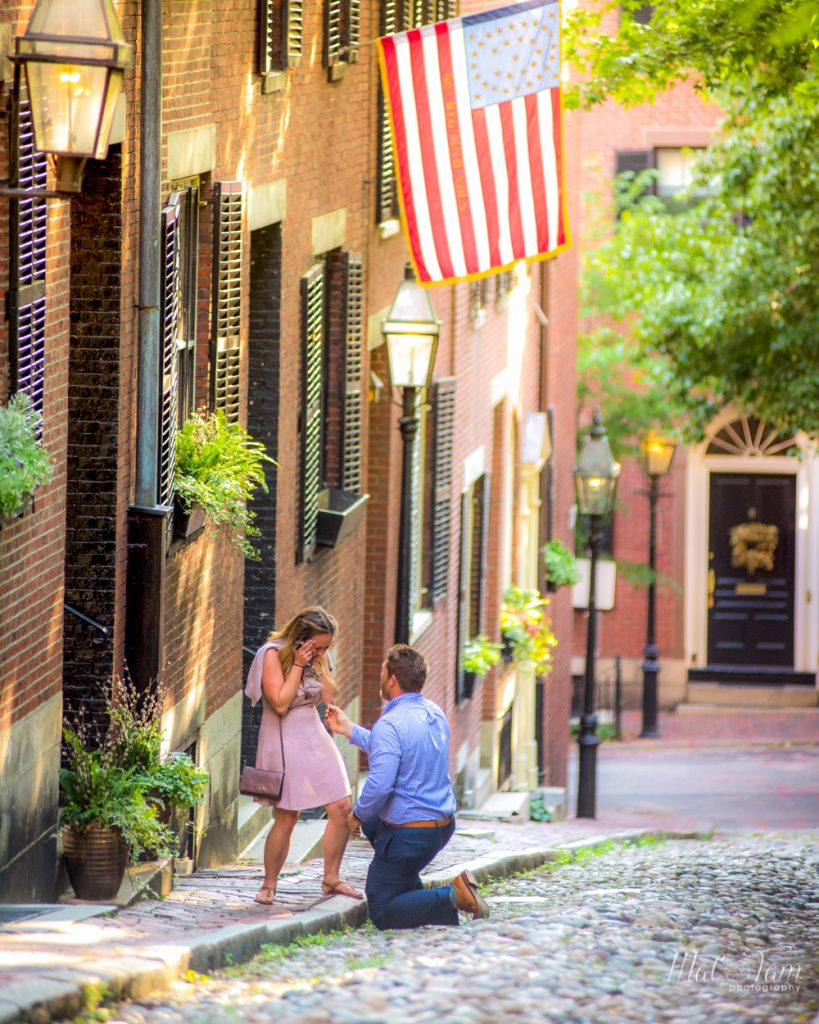 This guy proposing to his long time girlfriend at acorn street. And she was really surprised.
