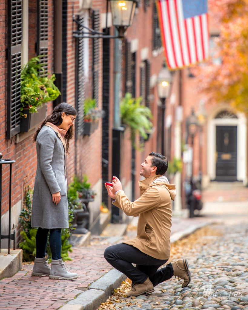guy proposing in the middle of the street in acorn street
